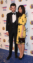 JACK WHITEHALL with GEMMA CHAN attends the British Comedy Awards at Fountain Studios, London, England, December 12, 2012. Photo by i-Images.