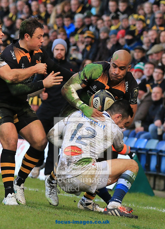 Tom Varndell of Wasps tackled by Remi Lamerat of Castres Olympique during the European Rugby Champions Cup match at Adams Park, High Wycombe<br /> Picture by Michael Whitefoot/Focus Images Ltd 07969 898192<br /> 14Duncan Taylor of Saracens2014