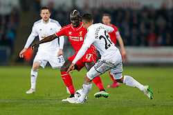 Mamadou Sakho of Liverpool is challenged by Kyle Naughton of Swansea City - Photo mandatory by-line: Rogan Thomson/JMP - 07966 386802 - 16/03/2015 - SPORT - FOOTBALL - Swansea, Wales — Liberty Stadium - Swansea City v Liverpool - Barclays Premier League.