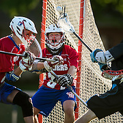 Pembroke Hill goalie Eric Koch (center) and Pembroke Hill's Parker Beaham (left) defended a shot on goal by Shawnee Mission East's Nick Bailey (right) during the quarterfinal match in the Lacrosse Association of Kansas City high school playoffs.