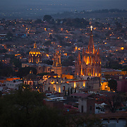 A twilight view of San Miguel de Allende, with La Parroquia rising up from the landscape. La Parroquia de San Miguel Arcángel, the current parish church of San Miguel, is unique in Mexico and the emblem of the town.The church was built in the 17th century with a traditional Mexican façade. The current Gothic façade was constructed in 1880 by Zeferino Gutierrez, who was an indigenous bricklayer and self-taught architect.