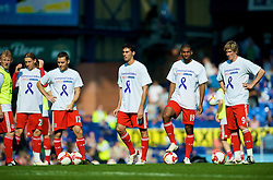 "LIVERPOOL, ENGLAND - Saturday, September 27, 2008: Liverpool players warm up before the 208th Merseyside Derby match against Everton at Goodison Park. He is wearing a t-shirt to support the ""Liverpool Unites"" charity, created in the memory of Rhys Jones, the young Everton fan who was shot dead in Croxteth last year. (Photo by David Rawcliffe/Propaganda)"