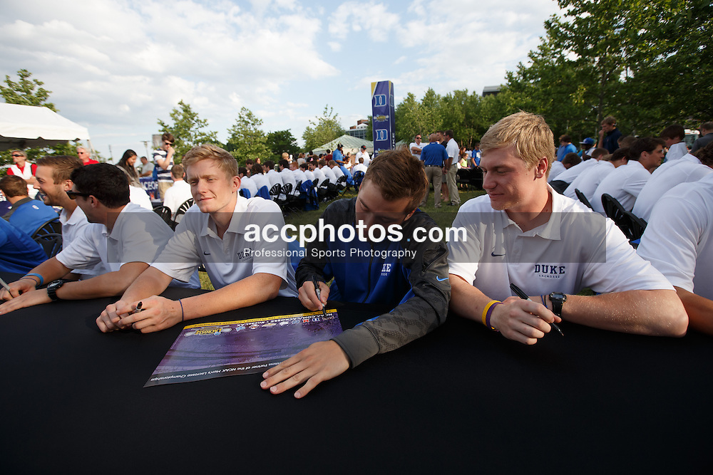 """2014 May 23: Chad Cohan #4 of the Duke Blue Devils during Friday Night Face Off (""""Fan Fest"""") on the Inner Harbor in Baltimore, MD."""