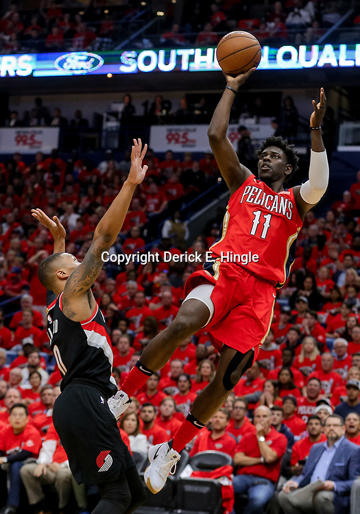 Apr 21, 2018; New Orleans, LA, USA; New Orleans Pelicans guard Jrue Holiday (11) shoots over Portland Trail Blazers guard Damian Lillard (0) during the first quarter in game four of the first round of the 2018 NBA Playoffs at the Smoothie King Center. Mandatory Credit: Derick E. Hingle-USA TODAY Sports