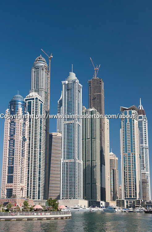 View of high-rise modern building towers in Marina at New Dubai in United Arab Emirates