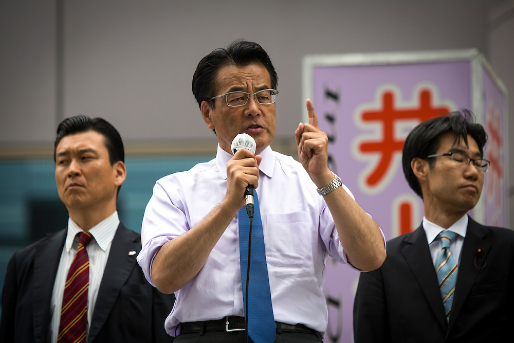 TOKYO, JAPAN - JULY 6 : Katsuya Okada President of Democratic Party of Japan (DPJ) delivers a campaign speech for his party candidate Toshio Ogawa during the Upper House election campaign outside of Machiya Station, Tokyo prefecture, Japan, on July 6, 2016. (Photo by Richard Atrero de Guzman/NUR Photo)