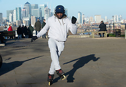 © Licensed to London News Pictures. 08/01/2019. Greenwich, UK. A rollerblader making the most of the sunny weather, Winter sunny weather at Greenwich Park,Greenwich today but temperatures at set to plunge. Photo credit: Grant Falvey/LNP