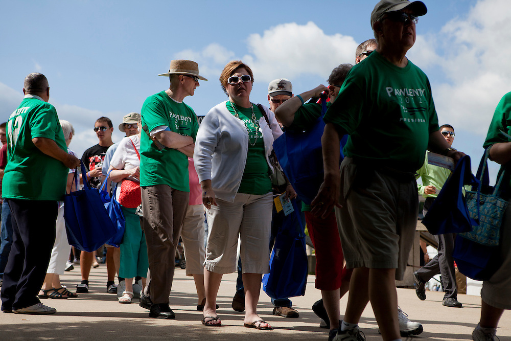 People line up to cast their ballots at the Iowa Republican Straw Poll on Saturday, August 13, 2011 in Ames, IA.