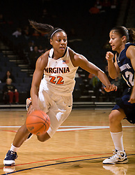 Virginia forward Monica Wright (22) cuts past Monmouth guard Marbely Montas (12).  The Virginia Cavaliers women's basketball team defeated the Monmouth Hawks 71-45 at the John Paul Jones Arena in Charlottesville, VA on December 18, 2008.