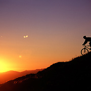 A picture of a man mountain biking on Mount Lincoln above Donner Summit, CA. This silhouette from the sierra mountains was taken near Truckee, CA.
