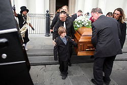03 Feb 2012. New Orleans, Louisiana USA. .Funeral mass for local hero Harry 'Mike' Ainsworth..Ainsworth's youngest son Dameon (9 yrs) leads the pall bearers carrying his father's coffin at Saint Louis Cathedral during the funeral mass remembering  Ainsworth, who was shot and killed in front of his boys as he attempted to thwart a carjacking in in Algiers Point. .Photo; Charlie Varley