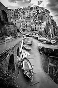 Black and white photograph of fishing boats  in Manarola, Cinque Terra
