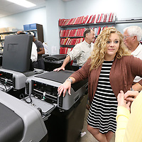 Lee County Circuit Clerk Camille Roberts Dulaney gets ready to start inspecting the new voting machines recently purchased.