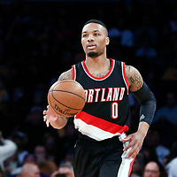 26 March 2016: Portland Trail Blazers guard Damian Lillard (0) brings the ball up court during the Portland Trail Blazers 97-81 victory over the Los Angeles Lakers, at the Staples Center, Los Angeles, California, USA.