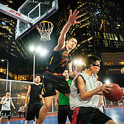 Tech workers relax with a game of basketball in front of an internet giant's office in Shenzhen, a high tech hub in southern China.
