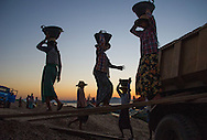 Women loading gravel from the Ayeyarwaddy River onto trucks near Bagan in Myanmar.