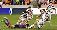 Stanford goalkeeper Andrew Epstein, bottom, slides towards his teammates after saving the shot of Wake Forest midfielder Brad Dunwell to win the game 5-4 in penalty kicks in an NCAA college soccer game, Sunday, Dec. 11, 2016, in Houston. (AP Photo/Eric Christian Smith)