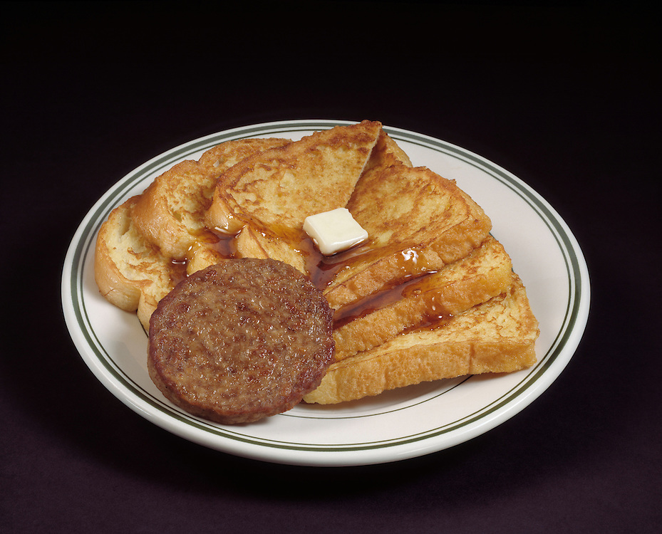 fast food hearty breakfast french toast sausage patty melted butter syrup white plate black background Bon Appetit traditional american breakfast concept conceptual metaphor lifestyle travel Dine Entertaining Entice Enticing Fed Feed Feeding Flavor Flavorful Foodshot Fragrant Haute Gourmet Gourmand Good Gratify Gratifying Grocery Healthfood Hospitable Hospitality Ingredient Lunch Market Munchy Marketplace Natural Organic Portion Pretty Produce Refresh Refreshing Satisfying Satisfaction Seasonal Serve Serving Smell Still life
