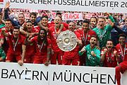 Bayern Munich's players and the team pose with the trophy after the German First division Bundesliga football match FC Bayern Munich v Eintracht Frankfurt in Munich, <br /> Arjen ROBBEN, Franck RIBERY,  RAFINHA, Sven ULREICH, Mats HUMMELS, David ALABA, 4 Niklas S&lsaquo;LE, Suele,  6 Thiago Alc&middot;ntara, Alcantara, 9 Robert Lewandowski, 18 Leon GORETZKA, 11, James RODRIGUEZ,  22 Serge GNABRY, 35 Renato SANCHES, 39 Ron-Thorben HOFFMANN, Keeper <br /> MUNICH, 18. MAY 2019,  Fc BAYERN vs Eintracht FRANKFURT, 5:1 - Bundesliga Football Match, <br /> FcBayern Muenchen vs Eintracht FRANKFURT Bundesliga match at Allianz Arena on 18.05.2019, DFL REGULATIONS PROHIBIT ANY USE OF PHOTOGRAPHS AS IMAGE SEQUENCES AND/OR QUASI-VIDEO - fee liable image, <br /> copyright &copy; ATP / Arthur THILL