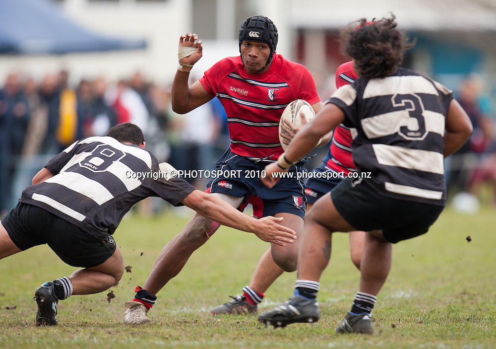 Kelston's Sosiceni Tokoqio comes up against Louis Rogers andTau Koloamatangi  during the NZ secondary schools boys rugby final for the Barbarian Cup between Kelston Boys High School and Wesley College, won 24-14 by Kelston at Rotorua Boys High School, Rotorua, New Zealand, Sunday 28 August 2011. Photo: Stephen Barker/PHOTOSPORT