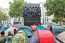 © Licensed to London News Pictures. 08/10/2019. LONDON, UK.  Tents erected by climate activists in a makeshift camp in Whitehall outside Downing Street, on day two of Extinction Rebellion's protest which is planned to close-down Westminster and other areas in the capital for two weeks.  Demonstrators are calling on the Government's immediate action to tackle the negative effects of climate change.  Photo credit: Stephen Chung/LNP