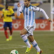 Ricardo Álvarez, Argentina, in action during the Argentina Vs Ecuador International friendly football match at MetLife Stadium, New Jersey. USA. 15th November 2013. Photo Tim Clayton