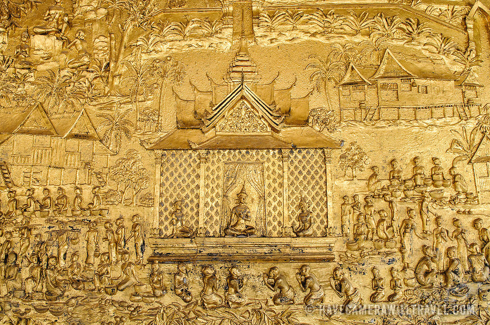 A section of the ornate decorations in the gold walls at Wat Mai Suwannaphumaham.  Wat Mai, as it is often known, is a Buddhist temple in Luang Prabang, Laos, located near the Royal Palace Museum. It was built in the 18th century and is one of the most richly decorated Wats in Luang Prabang.