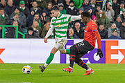 Lewis Morgan (#16) of Celtic crossed the ball during the Europa League match between Celtic and Rennes at Celtic Park, Glasgow, Scotland on 28 November 2019.