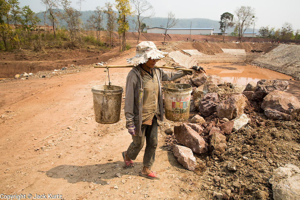 15 MARCH 2013 - LUANG PRABANG, LAOS: Construction work at a series of river catchments and reservoirs north of Luang Prabang, Laos. Much of the labor is done by hand without conventional safety tools like gloves or boots or hard hats.   PHOTO BY JACK KURTZ