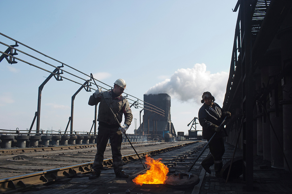 Employees of the Metinvest Coke Plant work on the furnaces where cokes are produced on March 18, 2015 in Avdiivka, Ukraine. Shells have hit the property of the plant over 150 times, including multiple hits on the plant itself.