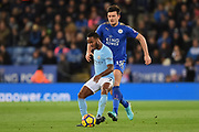 Manchester City midfielder Raheem Sterling (7) with Leicester City defender Harry Maguire (15) closing in during the Premier League match between Leicester City and Manchester City at the King Power Stadium, Leicester, England on 18 November 2017. Photo by Jon Hobley.