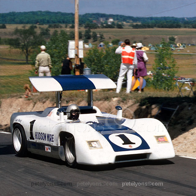 Sam Posey drives his Caldwell D7 Can-Am car into the pit lane at Road Americ, Elkhart Lake, in 1967. This innovative American car designed by Ray Caldwell featured de Dion suspension front and rear as well as a driver-adjustable overhead aerofoil (later removed).