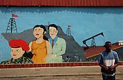 Caracas, Venezuela<br />Mural depicting Venezuela's oil wealth and red socialist beret of the revolution.