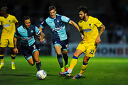 Callum Kennedy (23) of AFC Wimbledon takes on Sido Jombati (2) of Wycombe Wanderers and Dayle Southwell (15) of Wycombe Wanderers during the Pre-Season Friendly match between Wycombe Wanderers and AFC Wimbledon at Adams Park, High Wycombe, England on 25 July 2017. Photo by Graham Hunt.