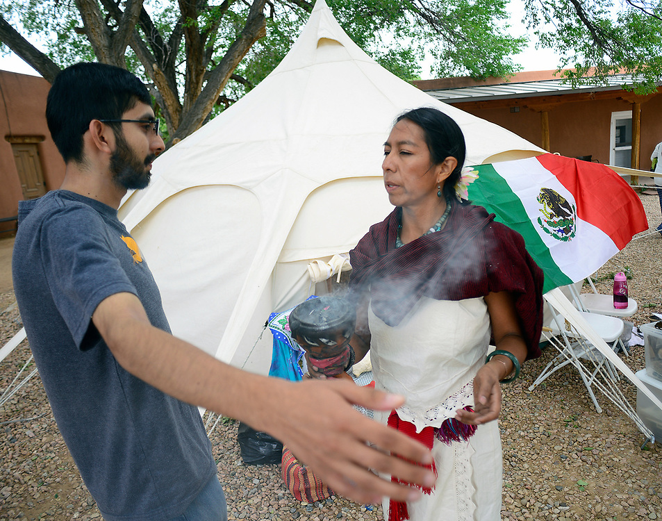 apl072317b/ASECTION/pierre-louis/JOURNAL 072317<br /> Curandera Maria Veronica Iglesias,,a native of Mexico City,  right, performs a limpia (spiritual cleansing) for Christian Medina,, of Santa Fe during the 10th Annual &quot;Viva Mexico Fiesta &quot; held at El Rancho de las Golondrinas .Photographed on Sunday July  23,  2017. .Adolphe Pierre-Louis/JOURNAL