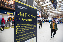 © Licensed to London News Pictures. 31/12/2017. London, UK. Information signs warn passengers of delays and cancellations to South Western Railway services from London Waterloo Station. Thousands of passengers travelling to celebrations on New Year's Eve are expected to face delays and cancellations because of a 24-hour walkout.  Photo credit: Rob Pinney/LNP