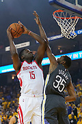 April 30, 2019; Oakland, CA, USA; Houston Rockets center Clint Capela (15) shoots the basketball against Golden State Warriors forward Kevin Durant (35) during the first quarter in game two of the second round of the 2019 NBA Playoffs at Oracle Arena.