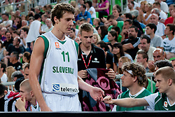 Goran Dragic of Slovenia greets co-players at friendly match between Slovenia and Montenegro for Adecco Cup 2011 as part of exhibition games before European Championship Lithuania on August 7, 2011, in SRC Stozice, Ljubljana, Slovenia. (Photo by Matic Klansek Velej / Sportida)