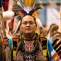 11031313    Brian Leddy<br /> Chance Sherman presents the eagle staff during the grand entry of a powwow for Sister Marguerite Bartz on Friday night in Ft. Defiance. St. Michael's Indian School held the event in memorial of the slain nun.