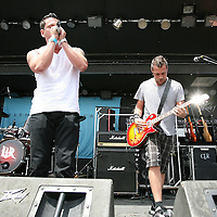 The band Within Reason performs at the Rockstar Uproar Festival at the 1-800-Ask-Gary amphitheater in Tampa, Florida on Thursday, September 13, 2012. (AP Photo/Alex Menendez)