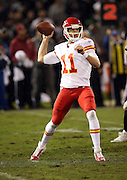Kansas City Chiefs quarterback Alex Smith (11) throws a 7 yard pass for a first quarter first down during the NFL week 12 regular season football game against the Oakland Raiders on Thursday, Nov. 20, 2014 in Oakland, Calif. The Raiders won their first game of the season 24-20. ©Paul Anthony Spinelli