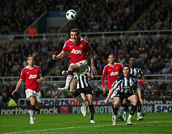 NEWCASTLE, ENGLAND - Tuesday, April 19, 2011: Manchester United's John O'Shea in action against Newcastle United during the Premiership match at St James' Park. (Photo by David Rawcliffe/Propaganda)