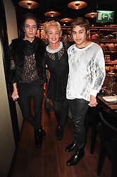 Left to right, TOMAS AUKSAS, AMANDA ELIASCH and PABLO GANGULI at a dinner in honour of Andre Leon Talley and Manolo Blahnik held at The Spice Market restaurant at W London, Leicester Square, London on 14th March 2011.