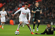 Tottenham Hostpur midfielder Deli Alli (20) dribbling and on his way to score during the Champions League match between Tottenham Hotspur and Real Madrid at Wembley Stadium, London, England on 1 November 2017. Photo by Matthew Redman.