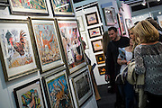 The Affordable Art Fair opens in Battersea and runs until 15 March. The fair offers visitors a chance to purchase work from over 100 galleries at prices between £50 and £4,000. Battersea Park, London UK 11 March 2015. Guy Bell, 07771 786236, guy@gbphotos.com
