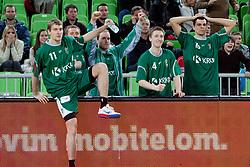 Players of KRKA Novo Mesto celebrate during basketball match between KK Union  Olimpija and and KK KRKA Novo Mesto in 20th Round of ABA League, on February 11, 2012, in Arena Stozice, Slovenia. (Photo by Matic Klansek Velej / Sportida)