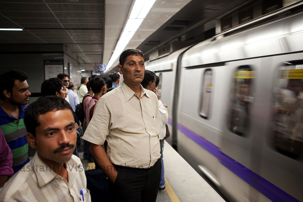 Veer Singh, 53 waits for a metro at the Central Secratariat station as he uses the Delhi Metro network for his daily official travels in New Delhi, India, on Friday, October 22, 2010. Photographer: Prashanth Vishwanathan/HELSINGIN SANOMAT