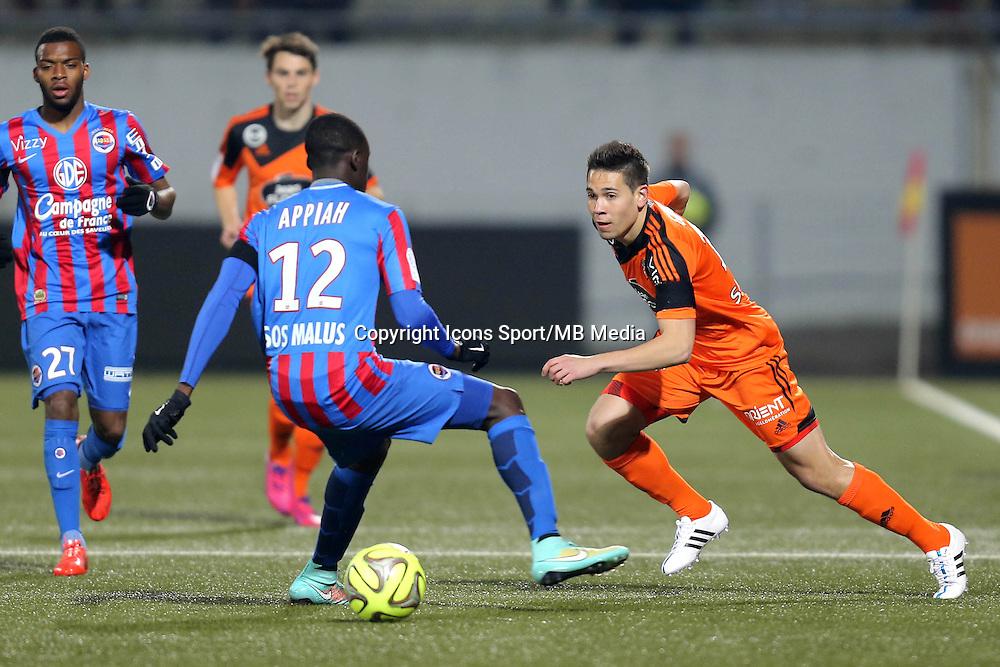 Raphael GUERREIRO / Dennis APPIAH - 14.03.2015 - Lorient / Caen - 29eme journee de Ligue 1<br /> Photo : Vincent Michel / Icon Sport