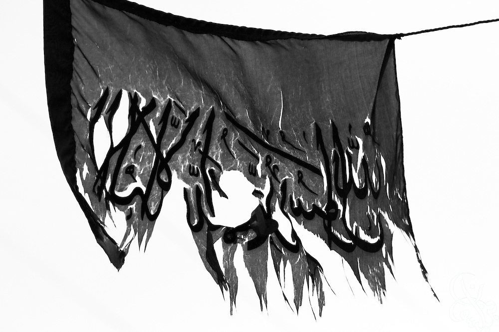 A weathered and ragged HAMAS flag hangs in the central market area of Gaza City December 27, 2009. After 22 years in existence, and the 22 day long Israeli Operation cast Lead a year ago, the militant Palestinian political group finds itself much like the flag, battered but still hanging in there. HAMAS remains widely popular across Gaza, which it seized more than two years ago from rival political party FATAH.