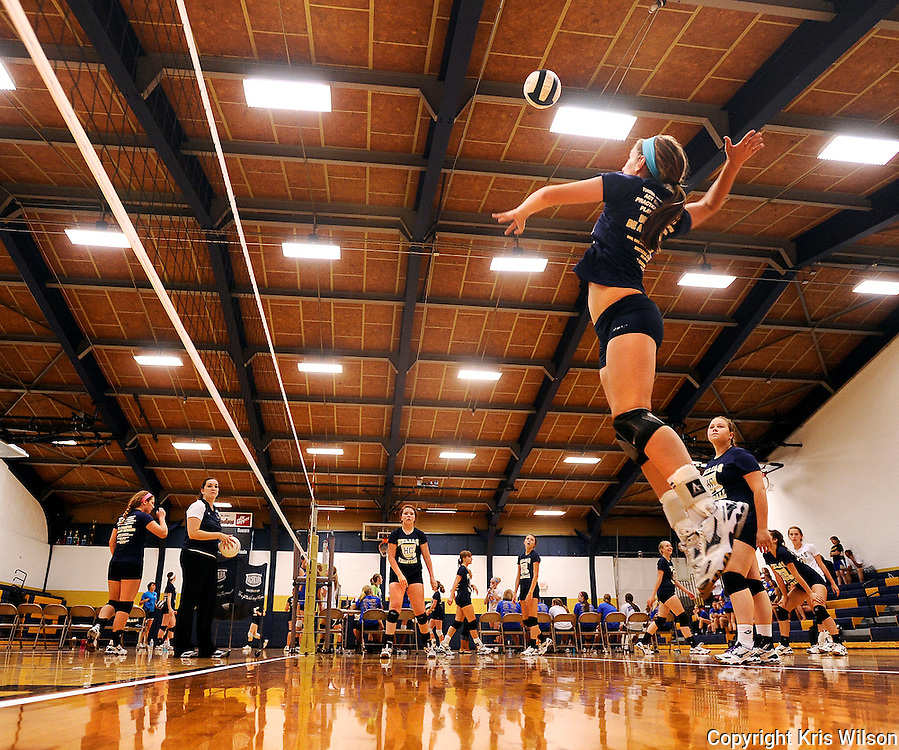 Kris Wilson/News Tribune.Morgan Rundle goes up for the kill as the Helias JV volleyball team goes through hitting drills during pre-game warm ups before the start of the championship game in the Helias JV/9th Grade Volleyball Tournament.